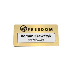 Złoty identyfikator personalizowany z okienkiem z logo firmy